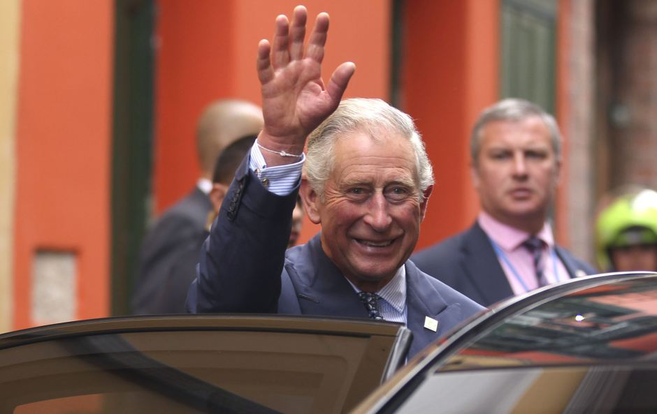 Britain's Prince Charles waves after visiting an organic fair at the British Ambassador's residence in Bogota