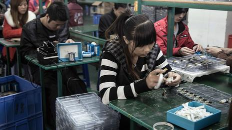 The assembly line at an MP3 factory in Shenzhen