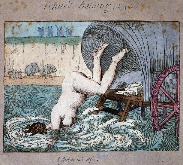 L0017751 A woman diving off a bathing wagon in to the sea. Coloured e