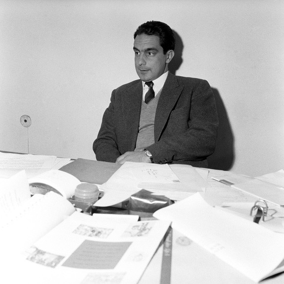 Italo Calvino seated in his studio