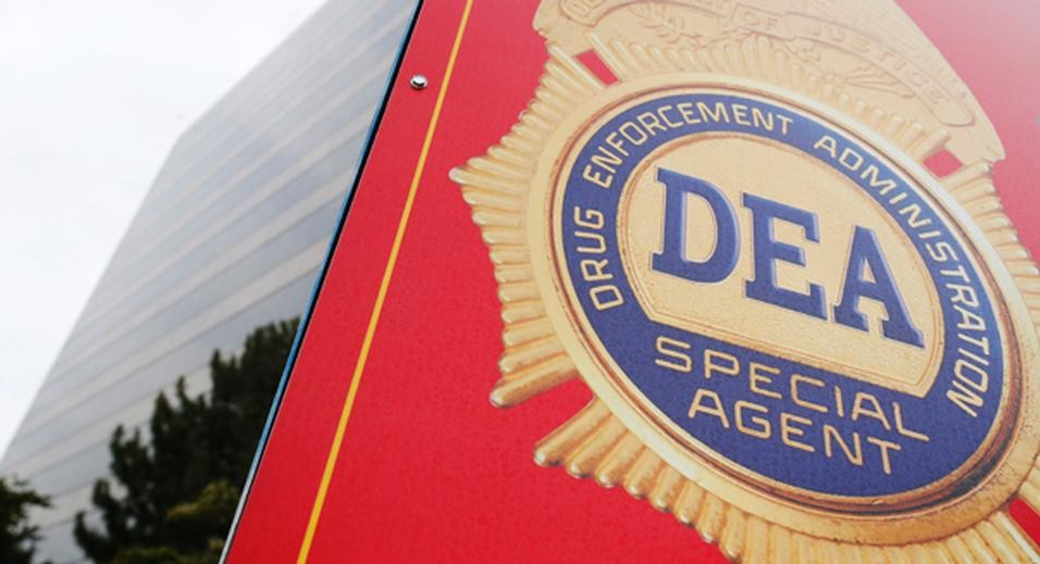 A sign with a DEA badge marks the entrance to the U.S. Drug Enforcement Administration (DEA) Museum in Arlington, Virginia